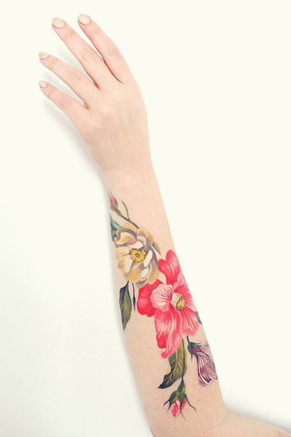 Beautiful flowers forearm tattoo