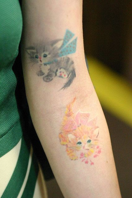 Beautiful funny little cat forearm tattoo