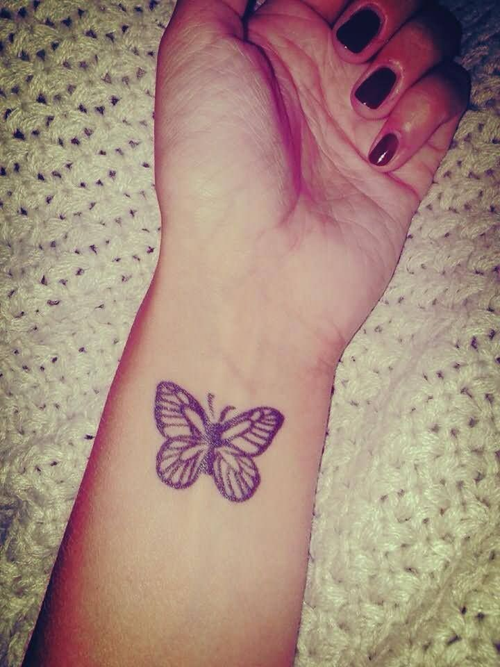 Beautiful gray ink butterfly wrist tattoo