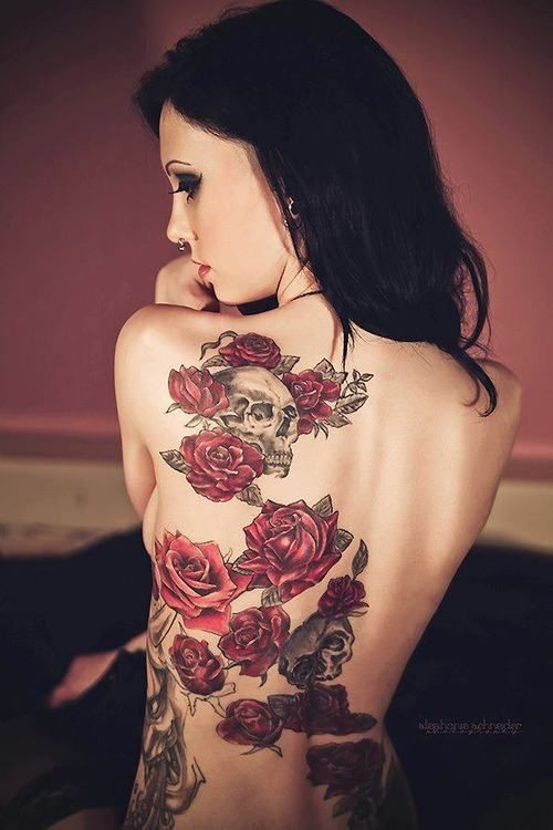Beautiful gray skulls and red roses tattoo on back