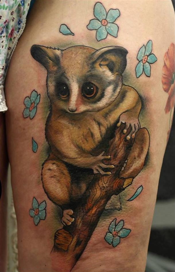 Beautiful illustrative style animal with flowers tattoo on thigh