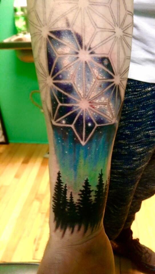 Beautiful illustrative style arm tattoo of interesting ornament with dark forest