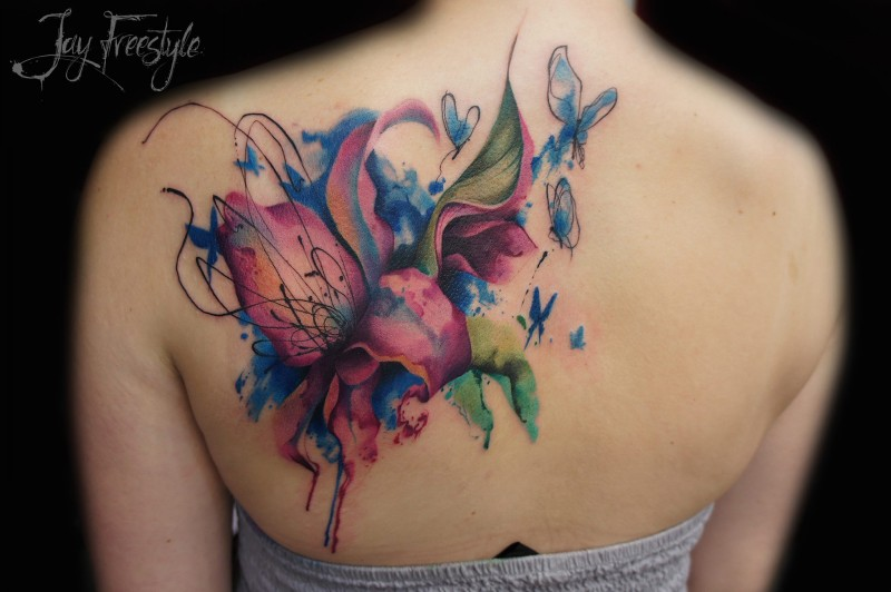 Beautiful illustrative style colored back tattoo of various flowers