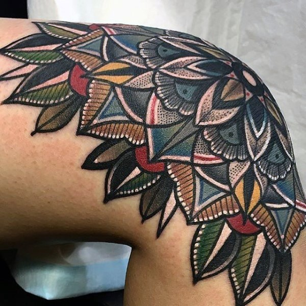 Beautiful illustrative style colored knee tattoo of large flower