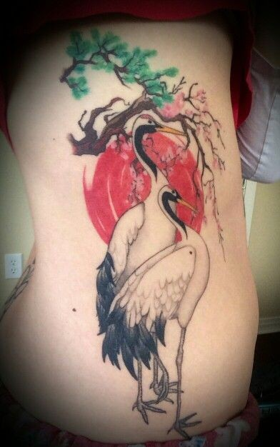 beautiful illustrative style colored side tattoo of birds and blooming tree