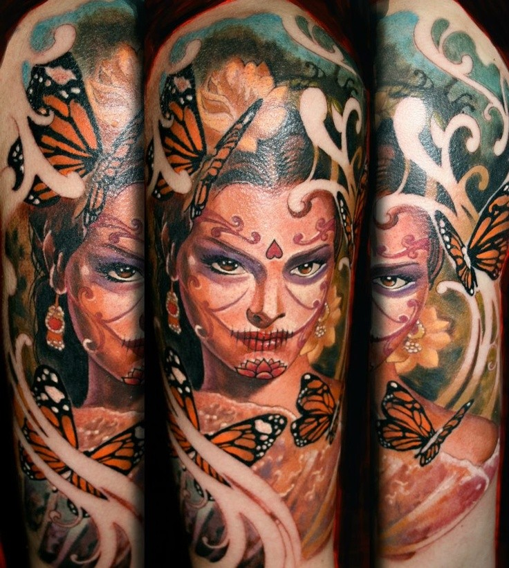 Beautiful illustrative style shoulder tattoo of woman portrait with butterflies