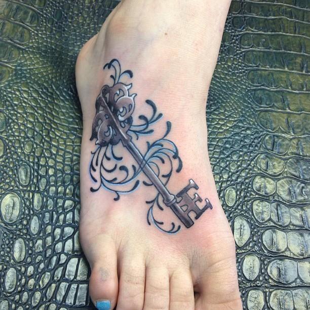 Beautiful key foot tattoo for women