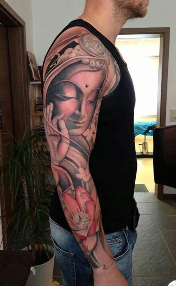 Beautiful large colored sleeve tattoo of Buddha statue with various flowers