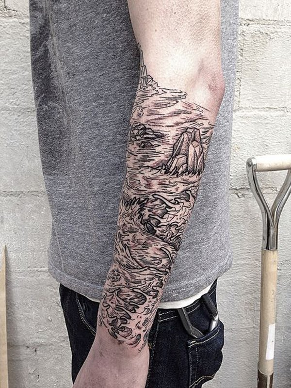 Beautiful looking black ink forearm tattoo of sea with rocks
