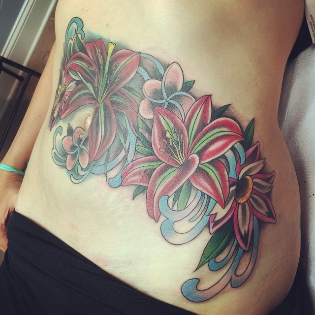 Beautiful looking colored belly tattoo of various flowers