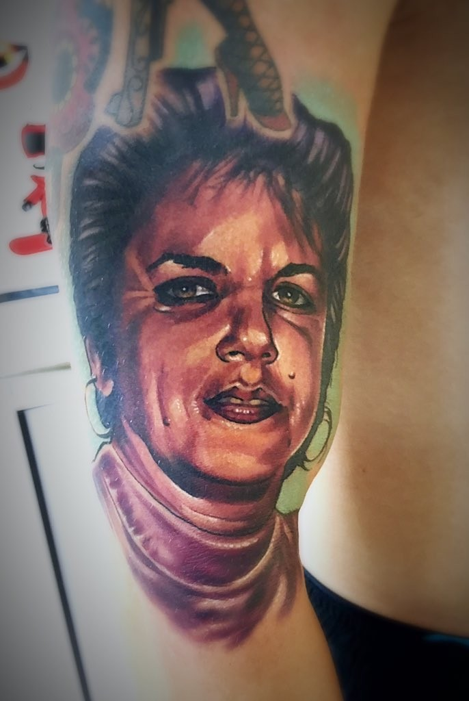 Beautiful looking colored biceps tattoo of woman portrait