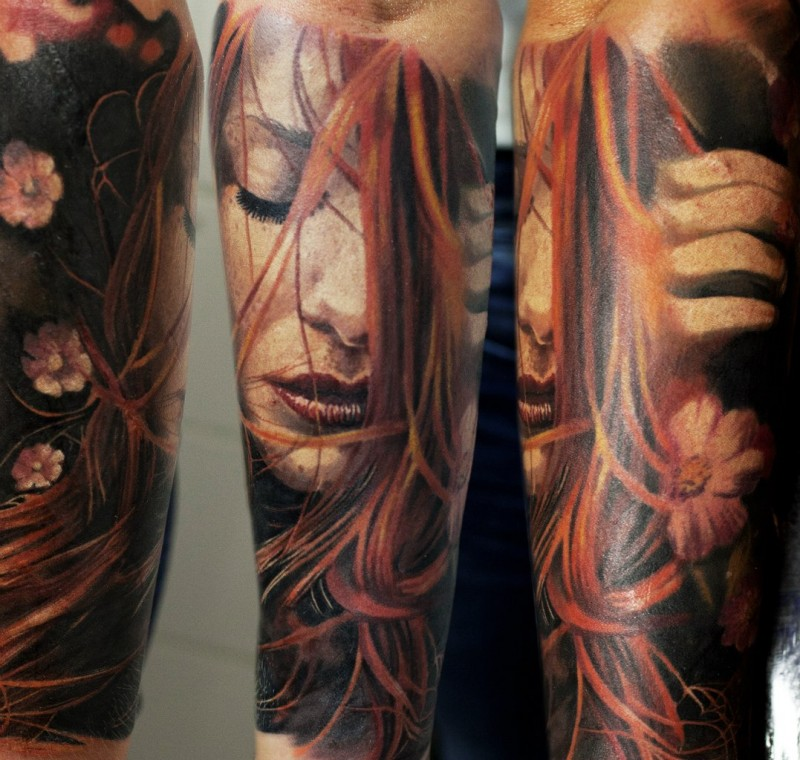 Beautiful looking colored forearm tattoo of sweet woman with flowers