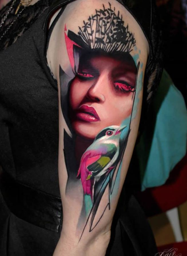 Beautiful looking colored shoulder tattoo of woman face with bird