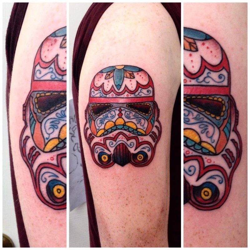 Beautiful looking colored shoulder tattoo of Storm troopers helmet stylized with various ornaments