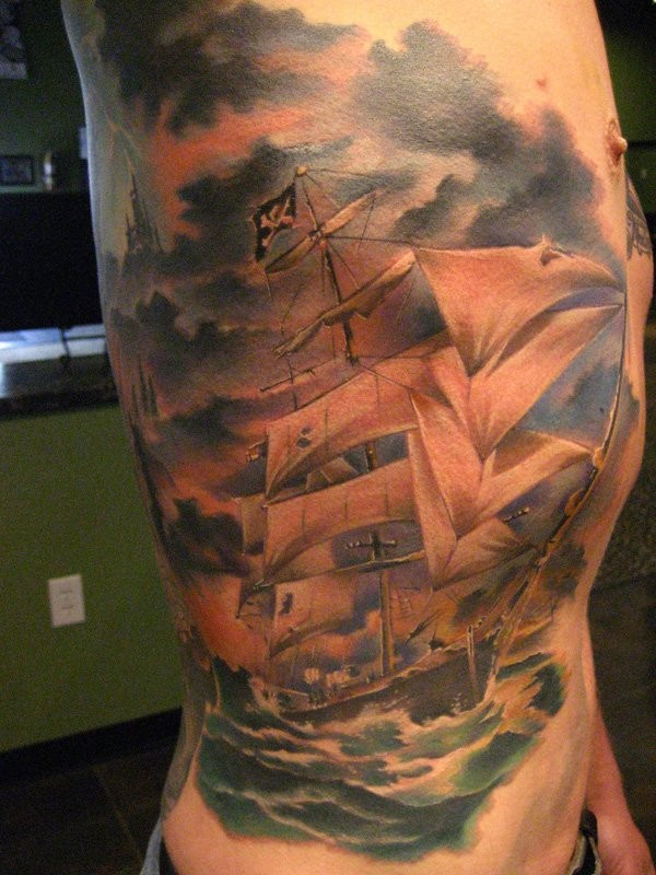 Beautiful looking colored side tattoo of big pirate sailing ship