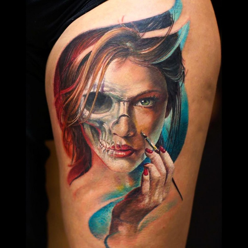 Beautiful looking colored thigh tattoo of mystical woman stylized with human skull part