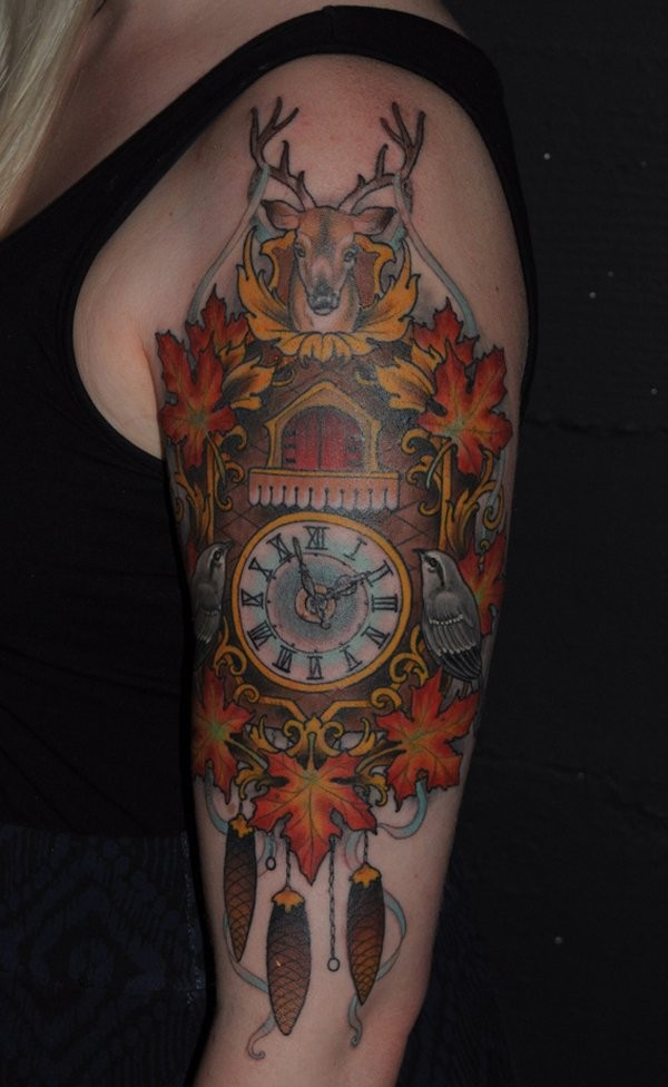 Beautiful looking colorful shoulder tattoo of wall clock stylized with various animals and leaves