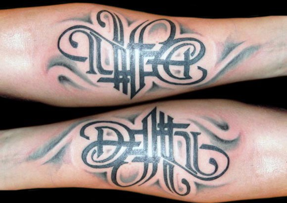 Beautiful looking forearm tattoo of lettering