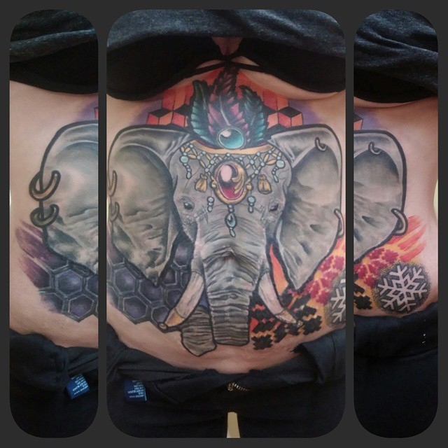 Beautiful looking illustrative style elephant with jewelry tattoo on belly