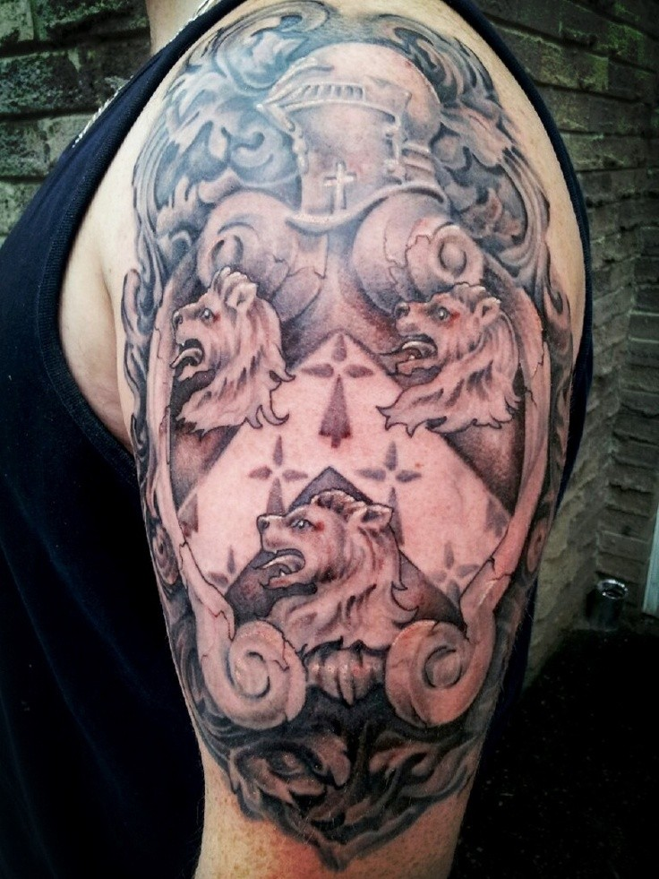 Beautiful medieval crest with knight and lions tattoo on half sleeve