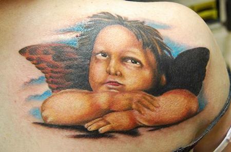 Beautiful michelangelo cherub tattoo