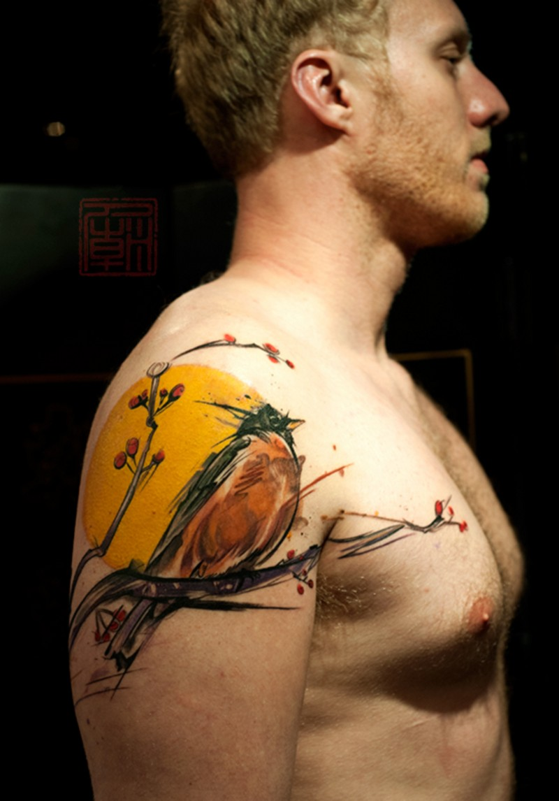 Beautiful multicolored shoulder tattoo of nice bird with blooming tree