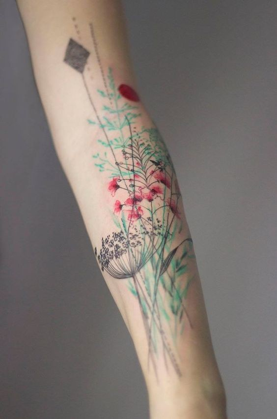Beautiful natural looking colorful various flowers tattoo on forearm zone