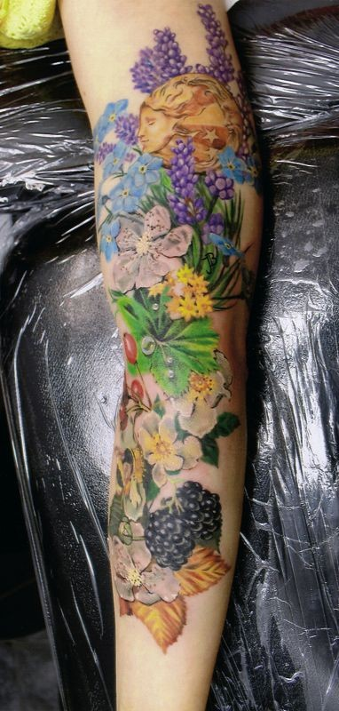 Beautiful natural looking forearm tattoo with flowers