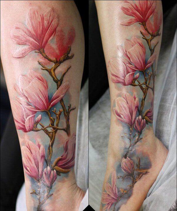 Beautiful natural looking leg tattoo of big flowers