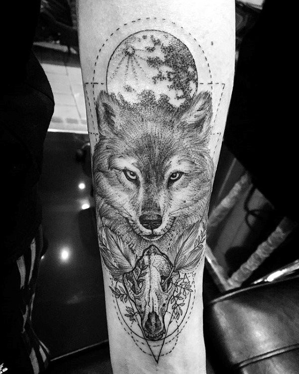 Beautiful nice looking forearm tattoo of animal skull with fox and moon