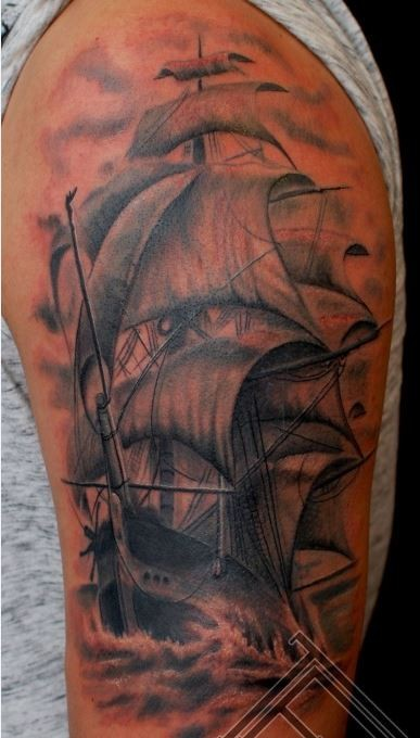 Beautiful old ship tattoo on shoulder