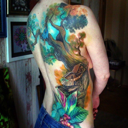 Beautiful painted and colored big back tattoo of tree house with flowers