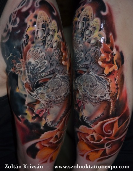 Beautiful painted and colored shoulder tattoo of woman with butterfly shaped mask