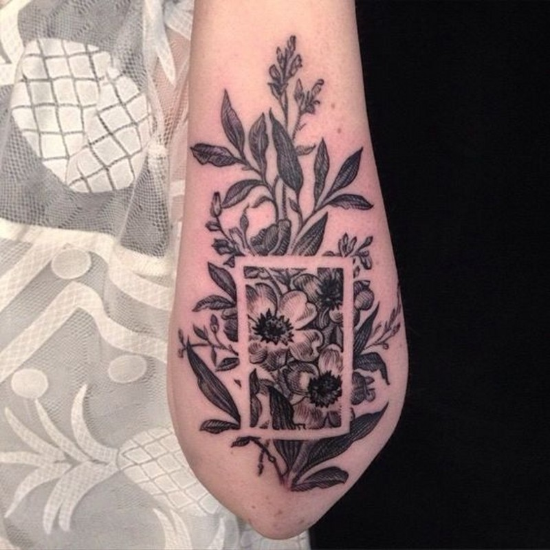 Beautiful painted black and white flowers tattoo on arm