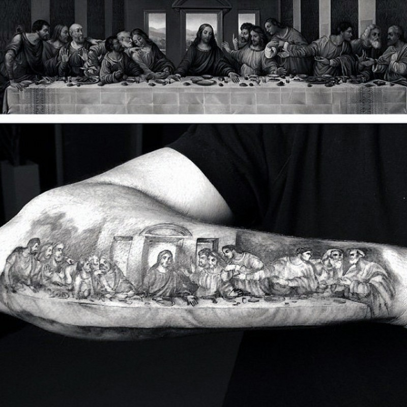 Beautiful painted black and white Lord&quots Supper picture tattoo on arm