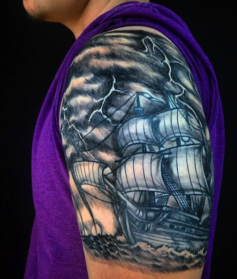 Beautiful painted black and white old sailing ship  tattoo on shoulder with lightning