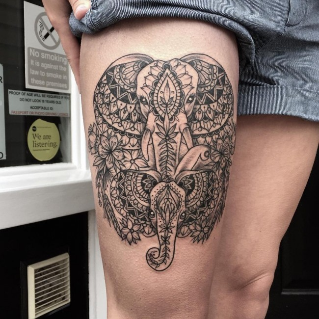 Beautiful painted black ink thigh tattoo of elephants stylized with ornaments