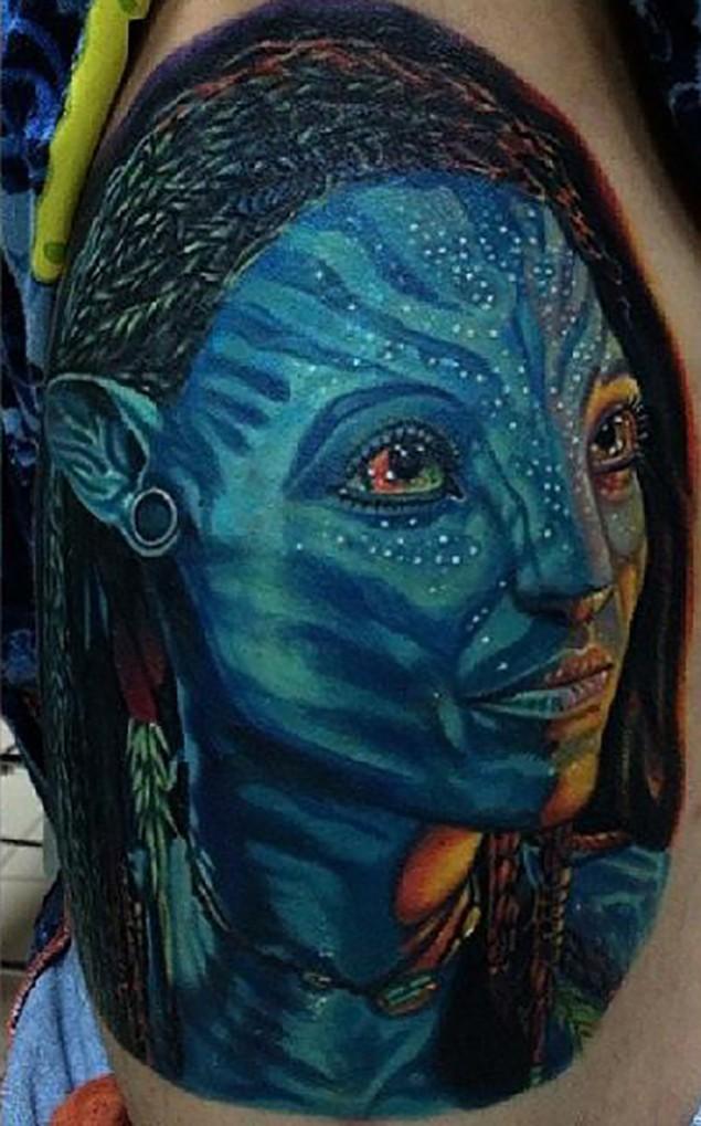 Beautiful painted colored Avatar woman portrait tattoo