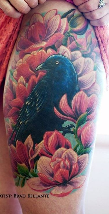 Beautiful painted colored crow tattoo on thigh combined with pink flowers