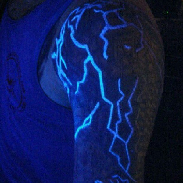 Beautiful painted glowing ink lightning tattoo on arm