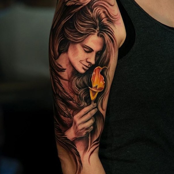 Beautiful painted illustrative style colored shoulder tattoo of woman with flower