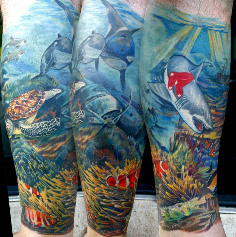 Beautiful painted multicolored underwater life tattoo on arm