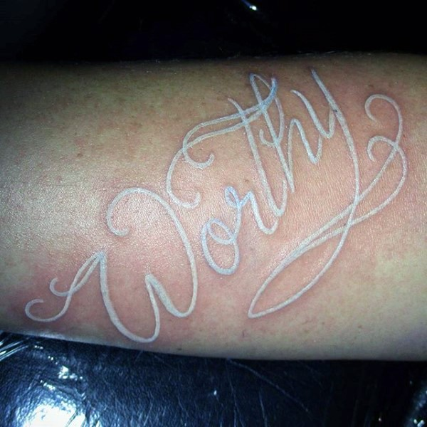 Beautiful painted white ink colored word tattoo on arm