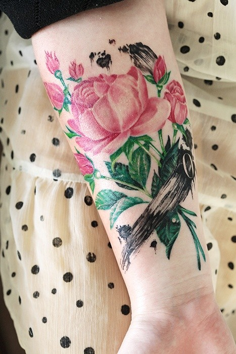 Beautiful pink rose wrist tattoo