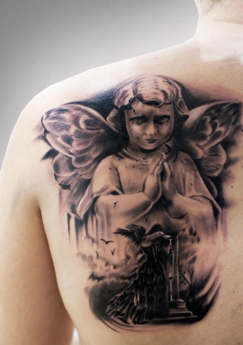 Beautiful praying cherub tattoo on shoulder blade