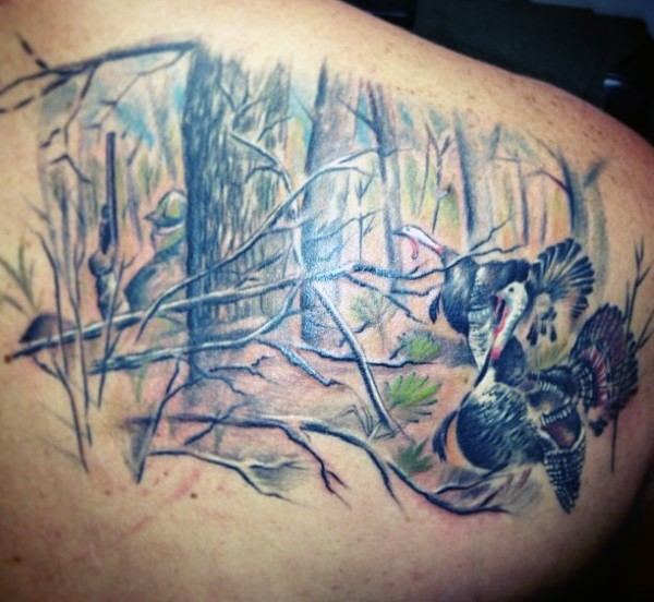 Beautiful realism style colored upper back tattoo of hunter in forest with birds