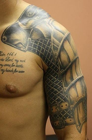 Beautiful realistic armor tattoo on shoulder