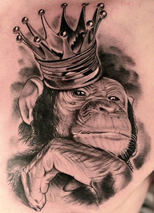 Beautiful realistic gray-ink chimpanzee in crown tattoo