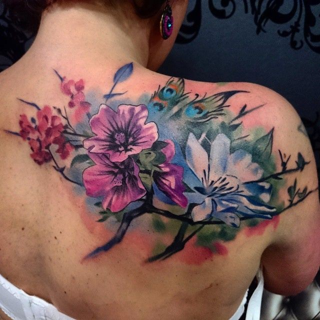 Beautiful realistic looking colored upper back tattoo of various flowers and butterflies
