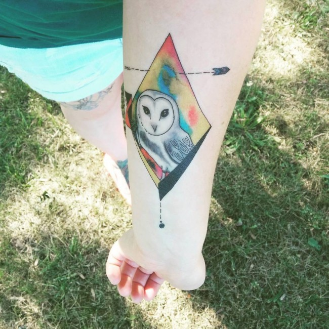 Beautiful rhomb shaped colored forearm tattoo stylized with white owl